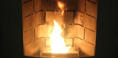 wood pellets burning in pellet burner
